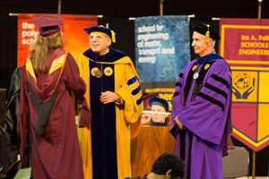 Ron Askin greets graduate student at Convocation