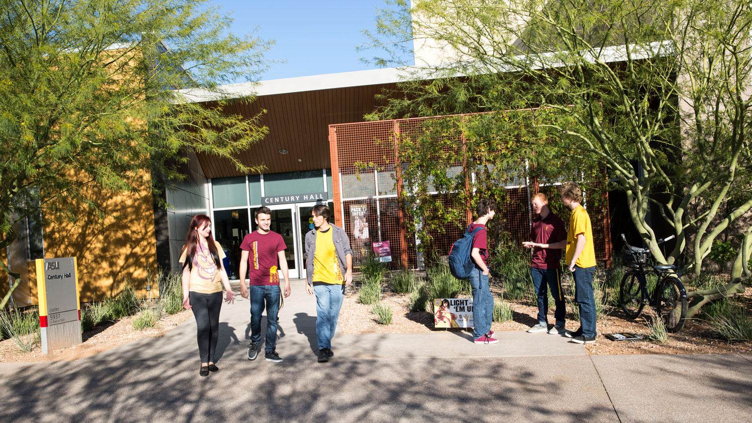 Students standing in front of Century Hall at the Polytechnic campus at ASU
