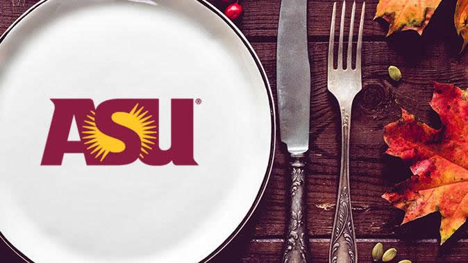 A table setting with an ASU logo plate