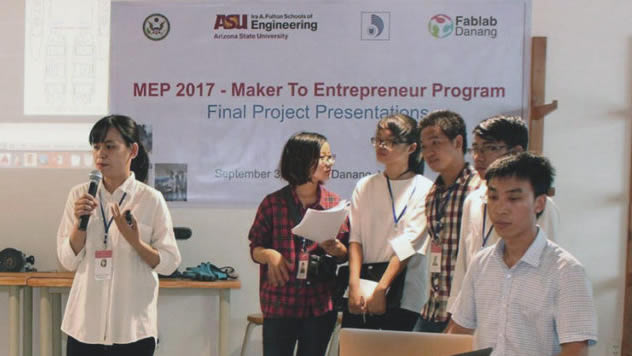 Six members of a Vietnamese student teams present product prototypes at the Maker to Entrepreneur Program's competition at the University of Danang's Maker Innovation Space