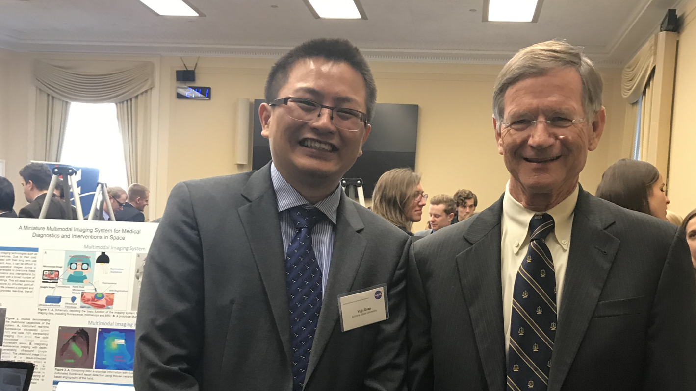 Yuji Zhao poses with U.S. Representative Lamar Smith, chairman of the Committee on Science, Space, and Technology.