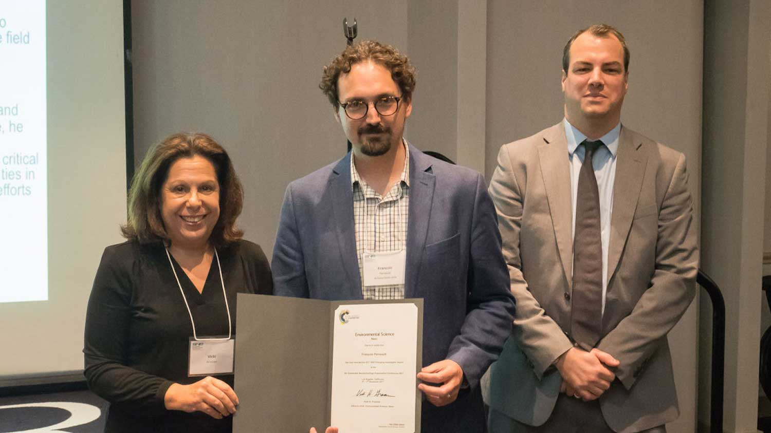 Assistant Professor Francois Perreault is shown receiving an award for advances in nanotechnology