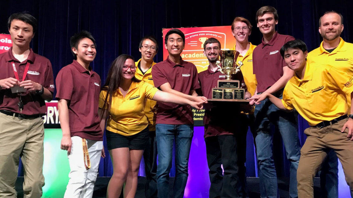 The Fulton Schools Maroon and Gold teams stand together to celebrate after the Maroon team won first place and the gold team second place at the 2018 ASU Academic Bowl title.