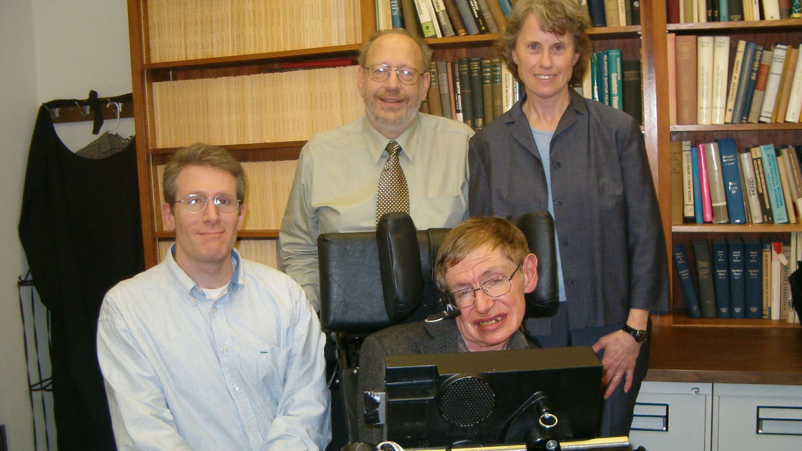 Famous physicist Stephen Hawking (foreground), disabled by neuromuscular disease, depended on scientists and engineers who developed the technologies that enabled him to overcome the loss of speech. Speech synthesis and acoustics experts who helped him included (from left behind Hawking) Arizona State University alum Michael Deisher and his colleagues, the late Edward Brucket and Corine Bickley, pictured here in 2005. Photograph courtesy of Michael Deisher.