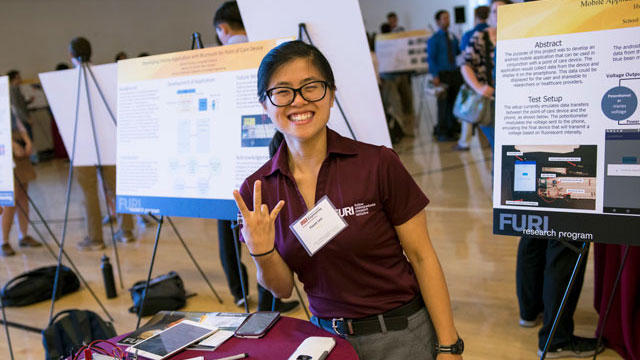 Hwee Lee with the android mobile application she developed as part of the Fulton Undergraduate Research Initiative (FURI).