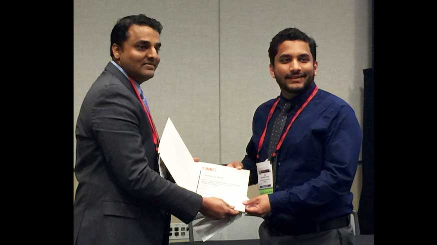 Chaitanya Kale accepts the Light Metals Division Magnesium Technology Award at the 147th Annual TMS Meeting for Best Student Paper