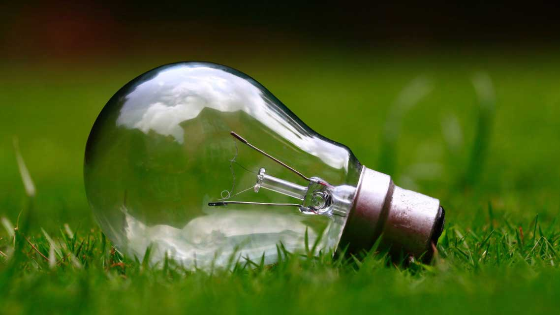 light bulb in grass stock image from Unsplash