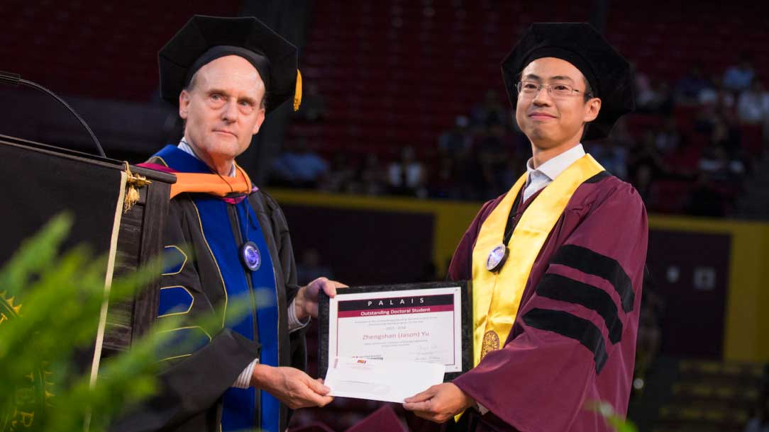 "Zhengshan ""Jason"" Yu receives the Palais Outstanding Doctoral Student Award from School of Electrical, Computer and Energy Engineering Director Stephen Phillips at the Ira A. Fulton Schools of Engineering Spring 2018 Gold Convocation Ceremony"