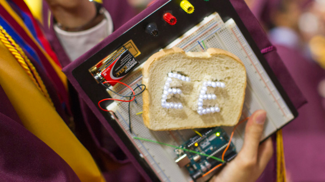 "A decorated mortarboard had circuitry powering a set of lights spelling ""EE"", charged by a slice of white bread."
