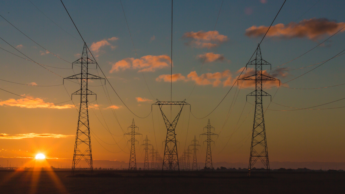 Image of electrical lines with a sunset backdrop