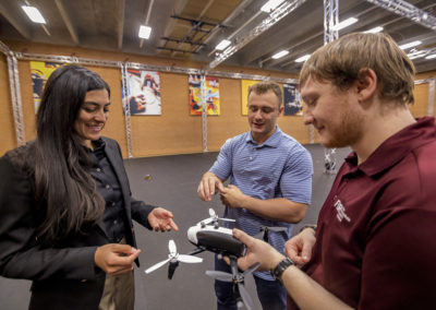 Professor Stephanie Gil oversees students in drone studio.