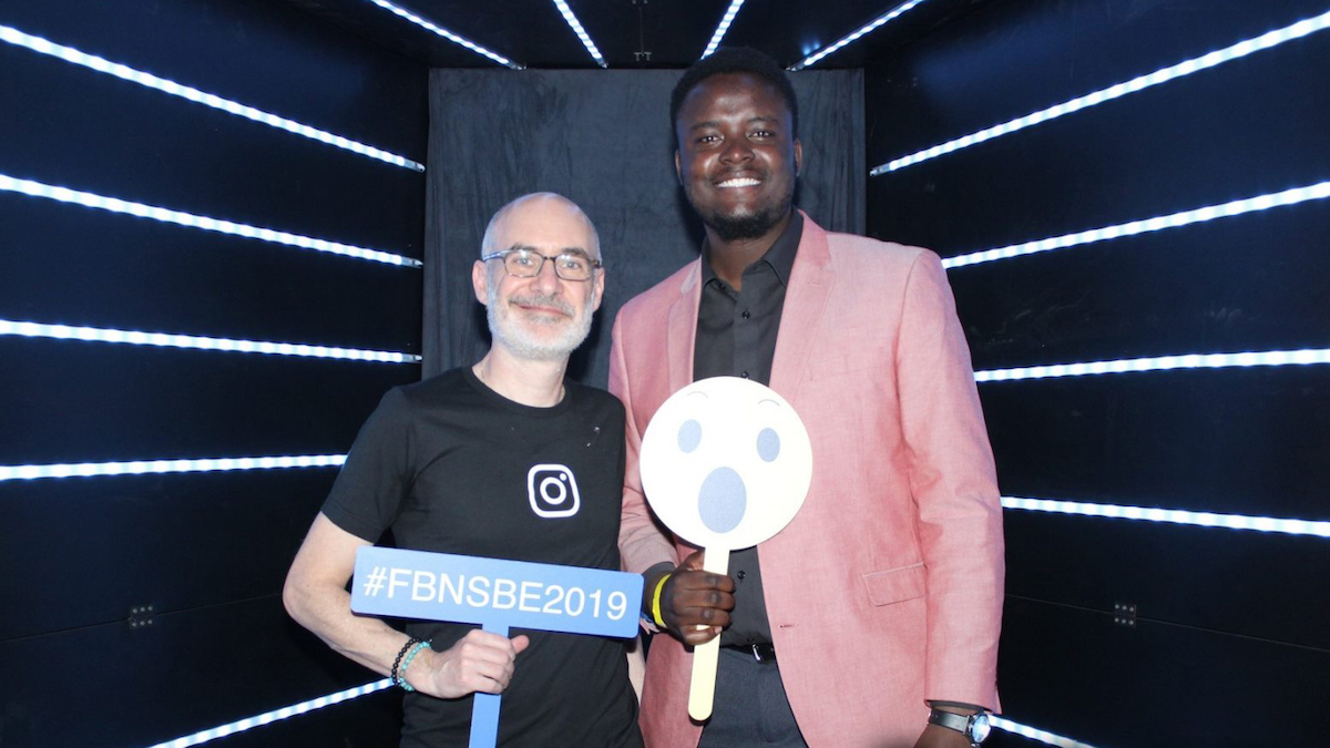 Dan Zigmond and Clive Matsika stand together for a photo