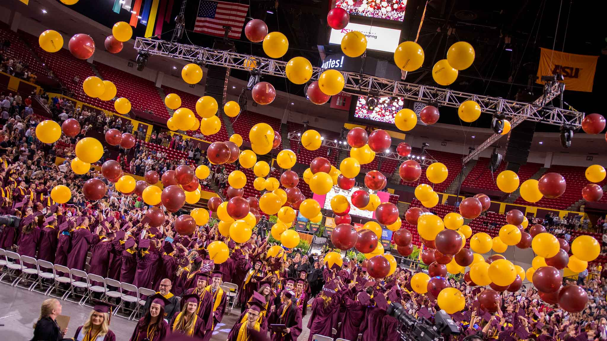 View of Desert Financial Arena full of engineering graduates and hundreds of balloons dropping from the ceiling
