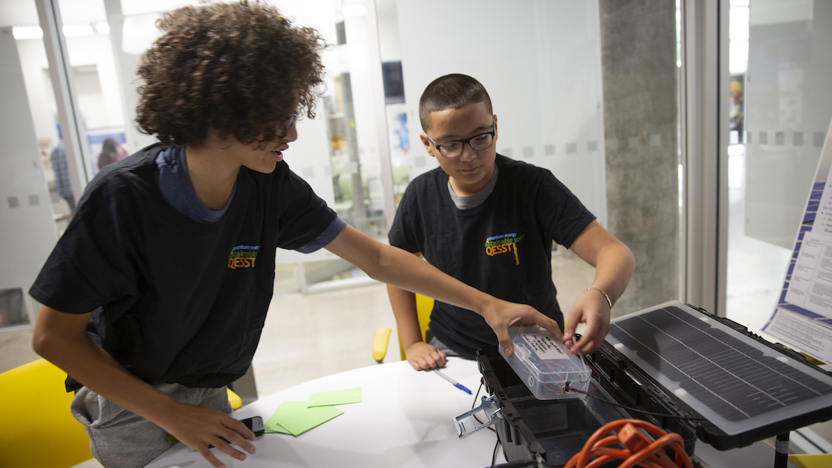 Two high school students work on a photovoltaic project