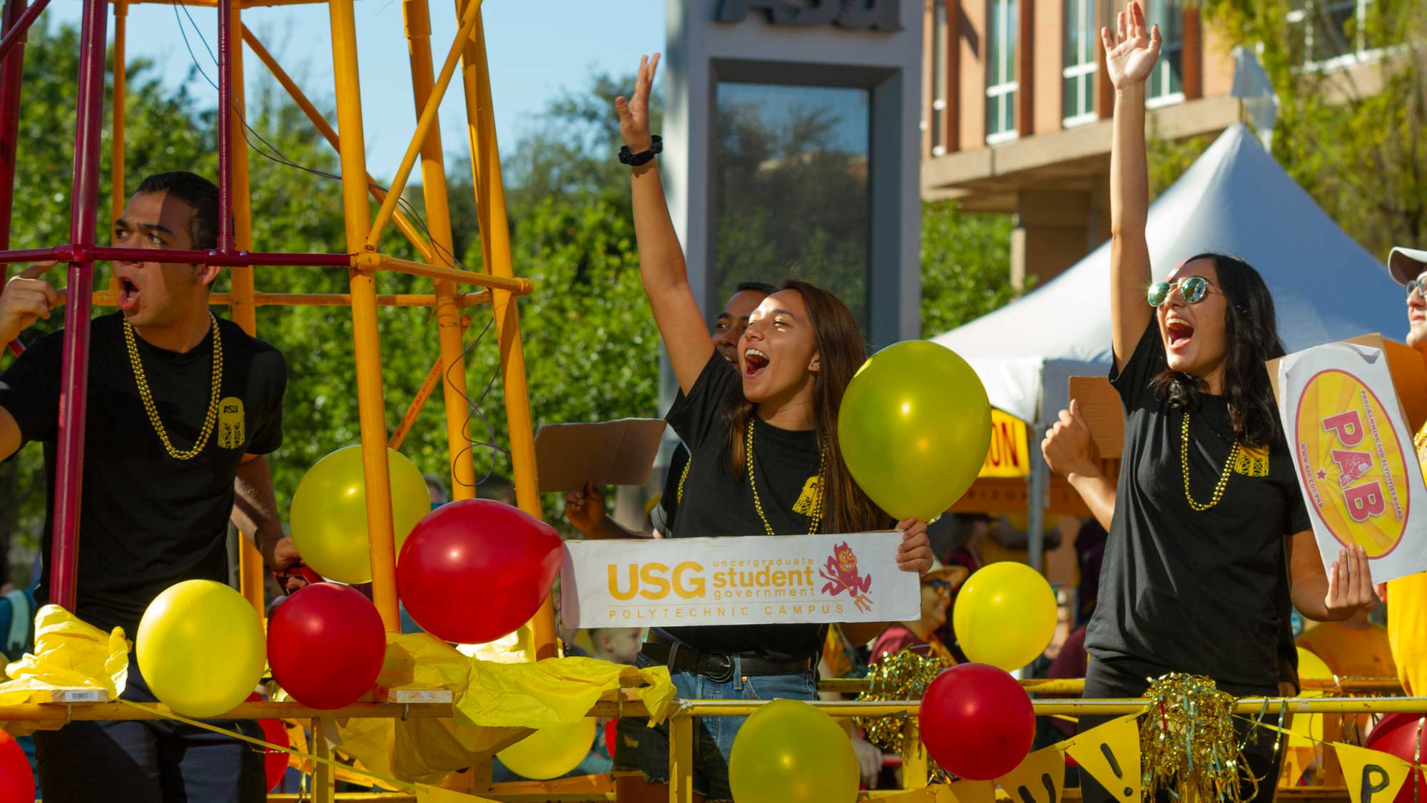 Fulton Schools students stand on a homecoming float, yelling with excitement