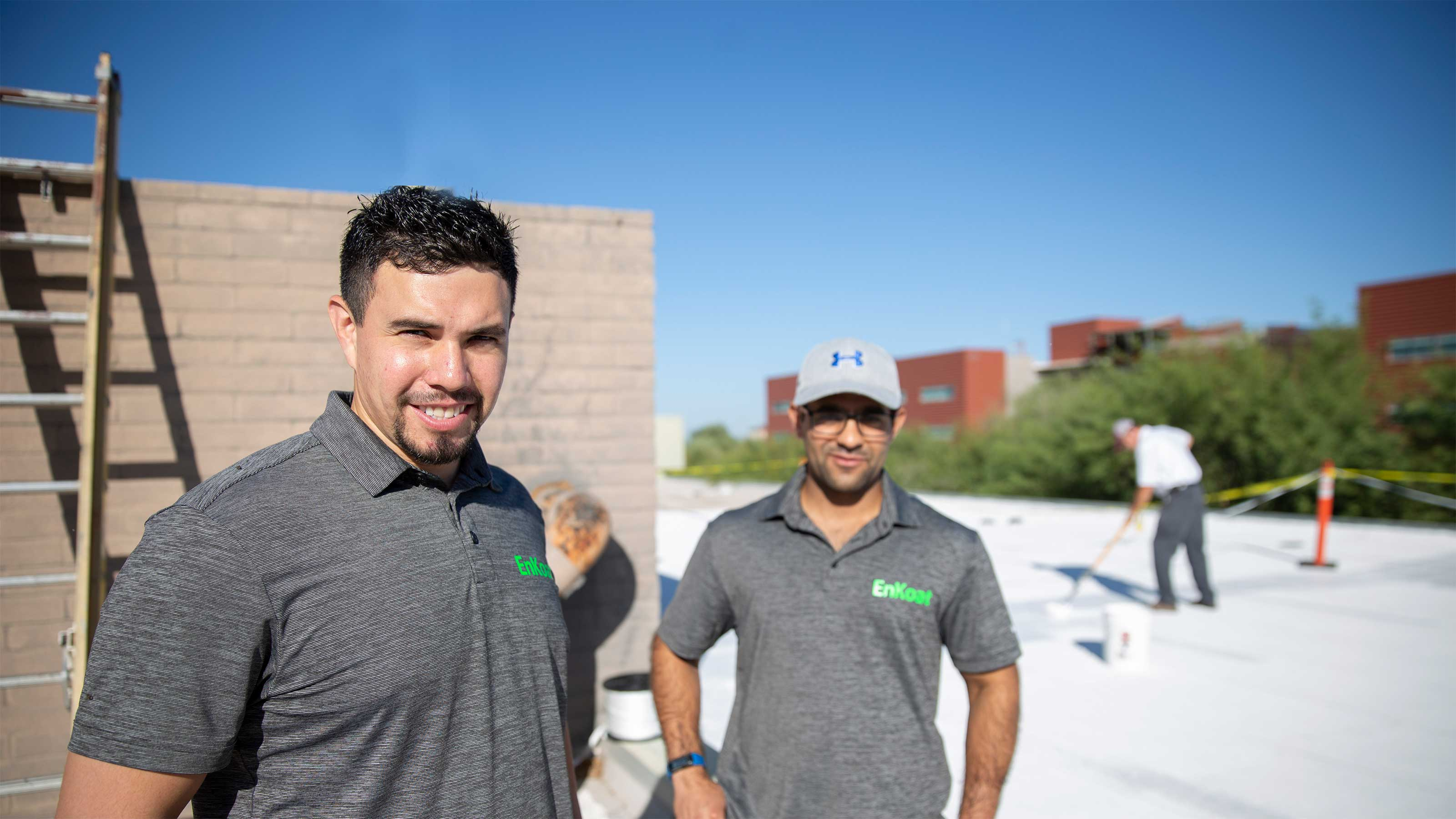 Matthew Aguayo (at left) and Aashay Arora pose atop the Agribusiness Center building