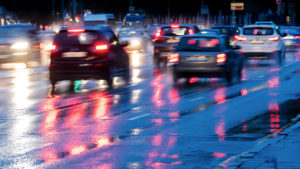 Stock image of traffic on a rainy highway at dusk