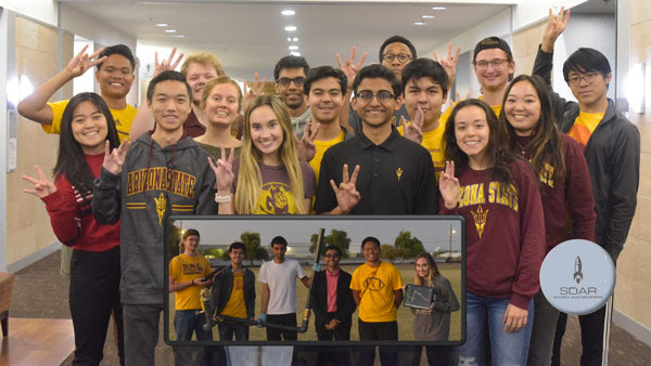 The 15 2019 ASU Alka Rocketeers stand in a group for a photo