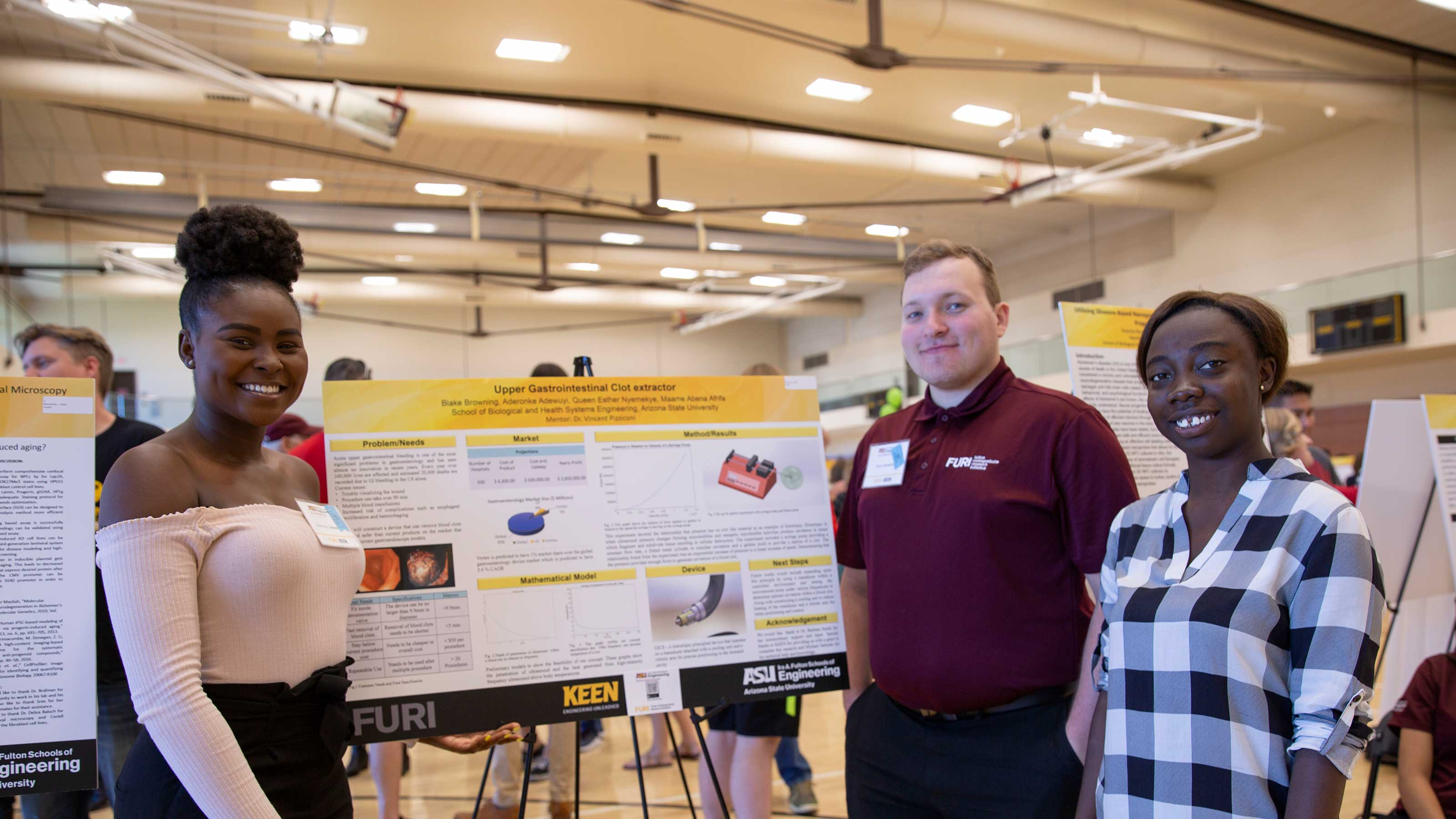 Aerial view of an ASU gymnasium during the FURI symposium and MORE graduate research event, showing hundreds of students by their posters talking about their research.