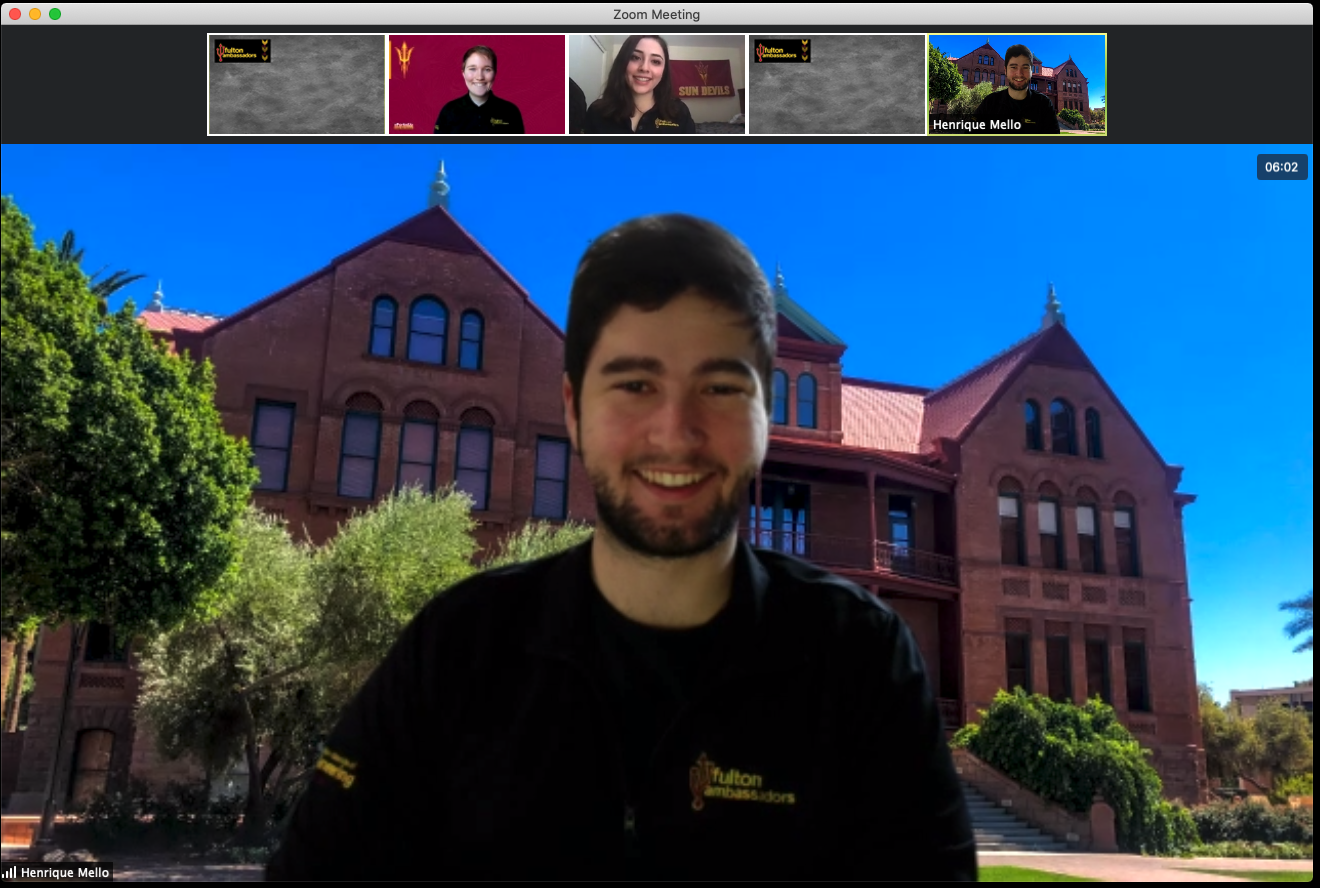 A prospective student chats to current students during a virtual visit