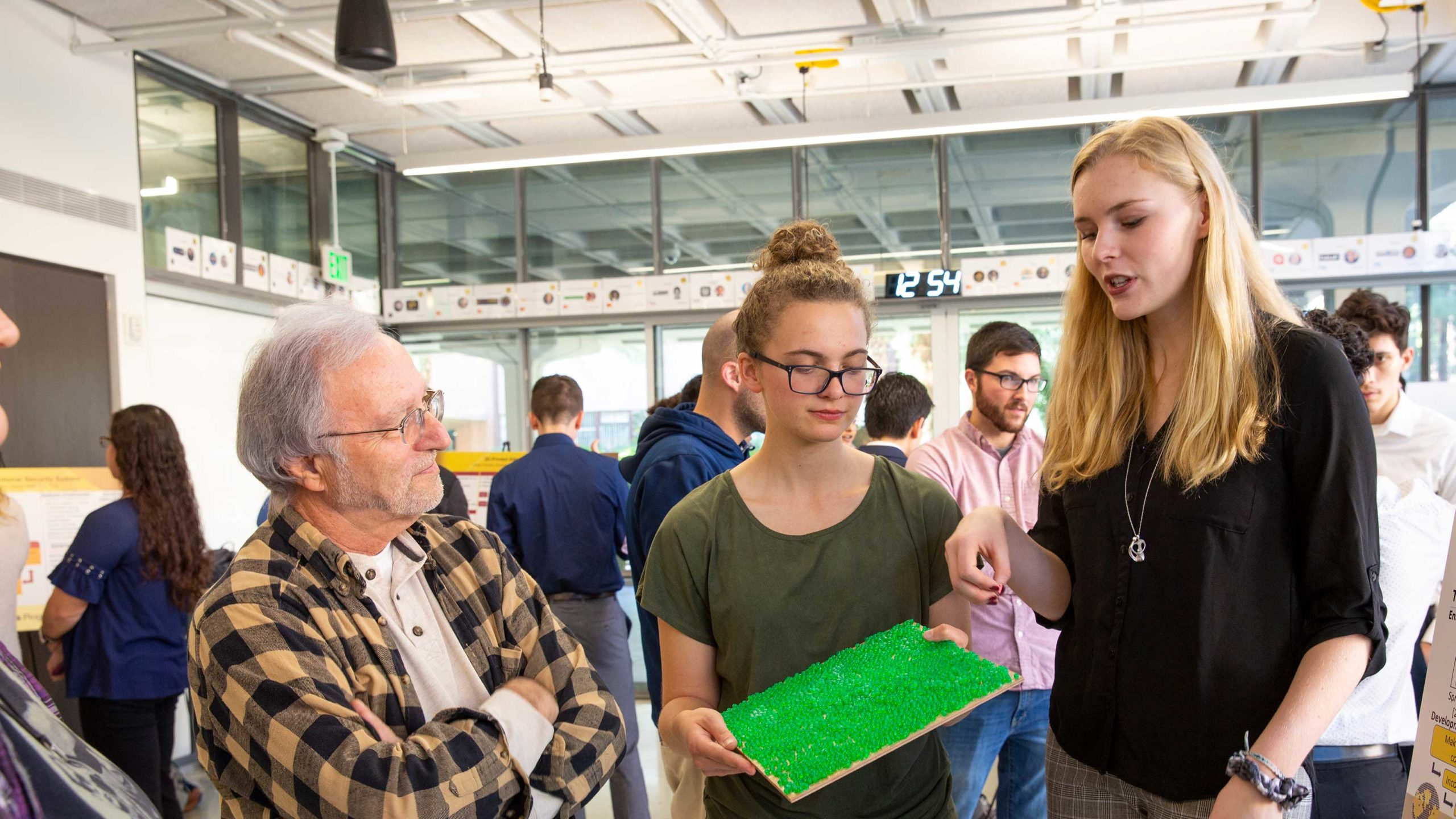 Emily Hagood and Audrey Schlichting present their theoretical photosynthetic paint project at the Futuristic Solutions for the Grand Challenges poster presentation