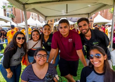 A group of Hispanic students pose for the camera at a Fulton Schools outdoor event
