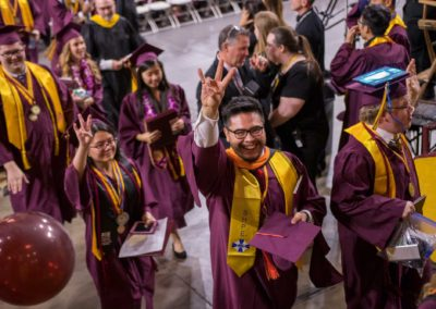 a SHPE graduate poses for the camera as he leaves the Fulton Schools convocation