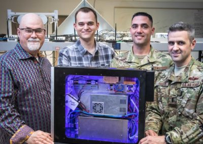 Dan Bliss and the three other members of the Making Waves team stand with their proof-of-concept threat emitter, DUMTE