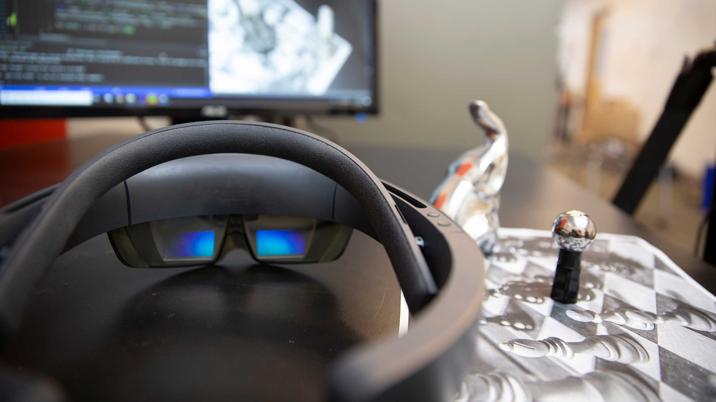 Image with VR goggles and other equipment used in Robert LiKimWa's research