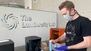 Graduate research assistant Clinton Ewell works in Luminosity's facilities at the Polytechnic campus