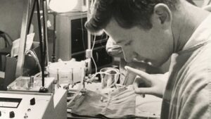 black and white photo of The late ASU Professor William Dorson working in a lab at St. Joseph's Hospital