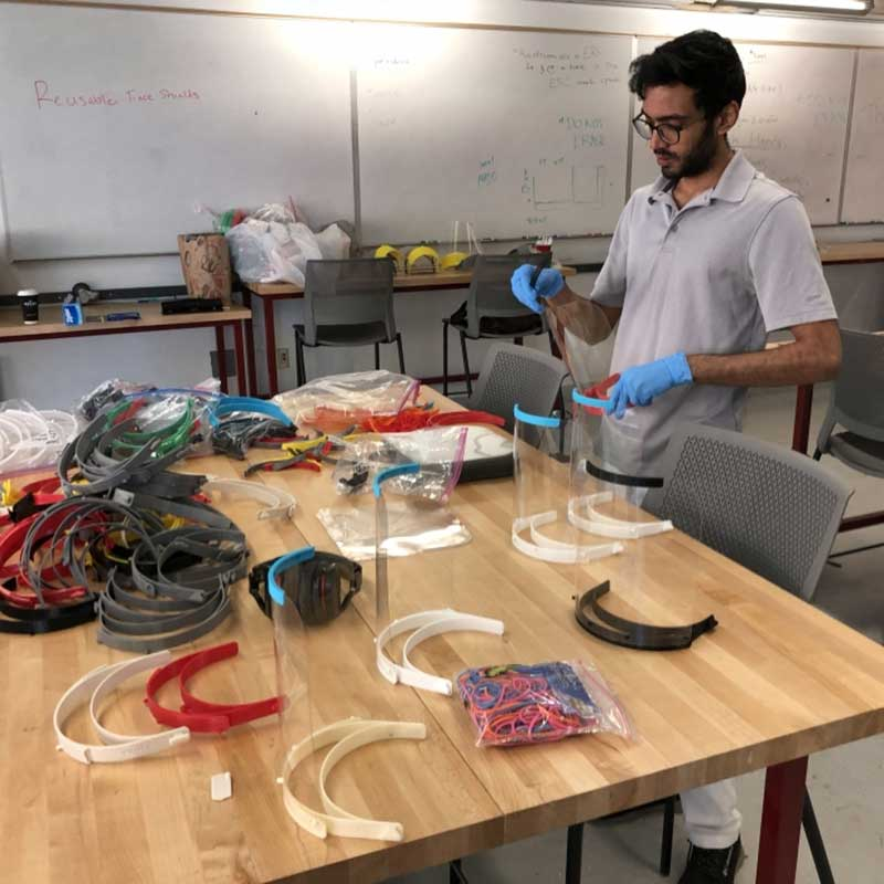 A volunteer from the Luminosity lab makes PPE equipment