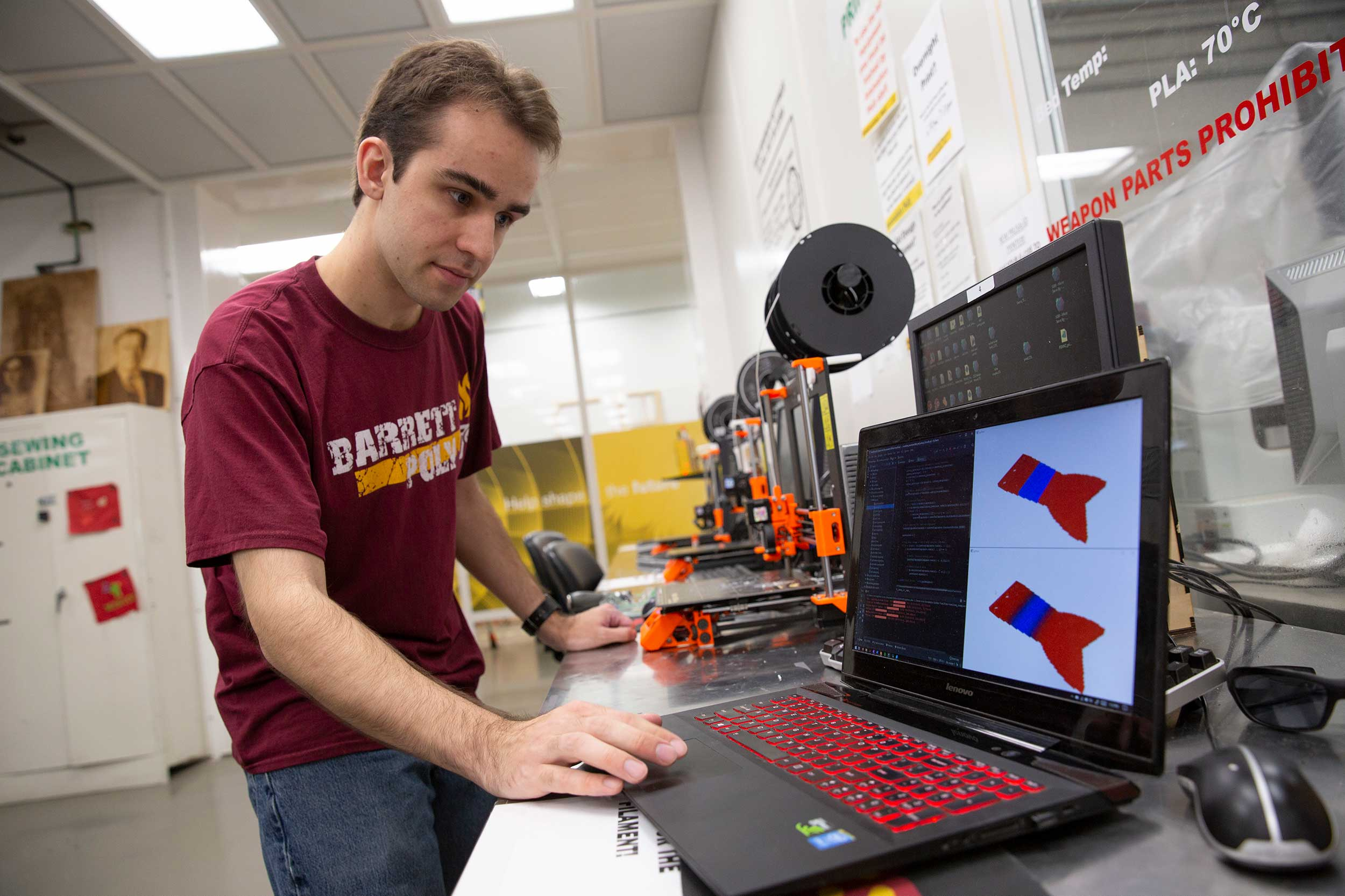 An ASU Engineering student works on a project a lab