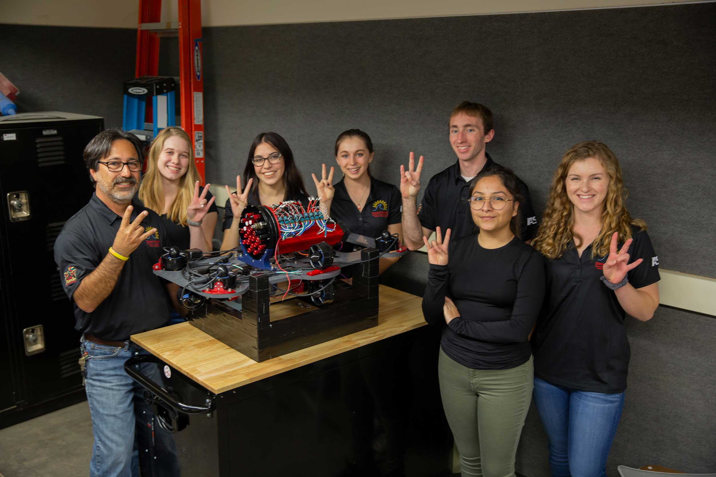All-female Desert WAVE robotics team with mentors and others