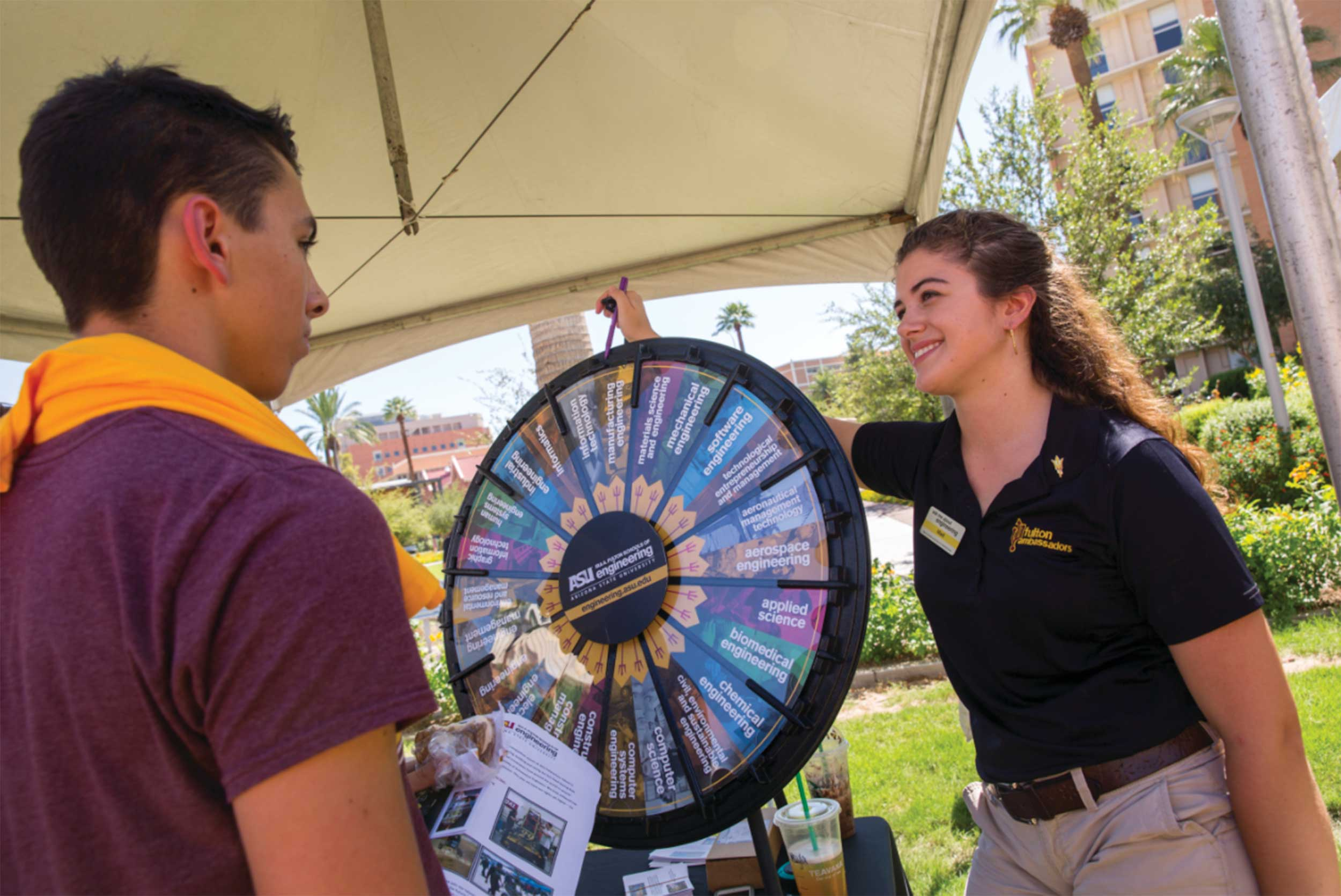 A Fulton Ambassador (right) shows the wheel of degrees to a student at the Fulton Schools Student Resource Fair