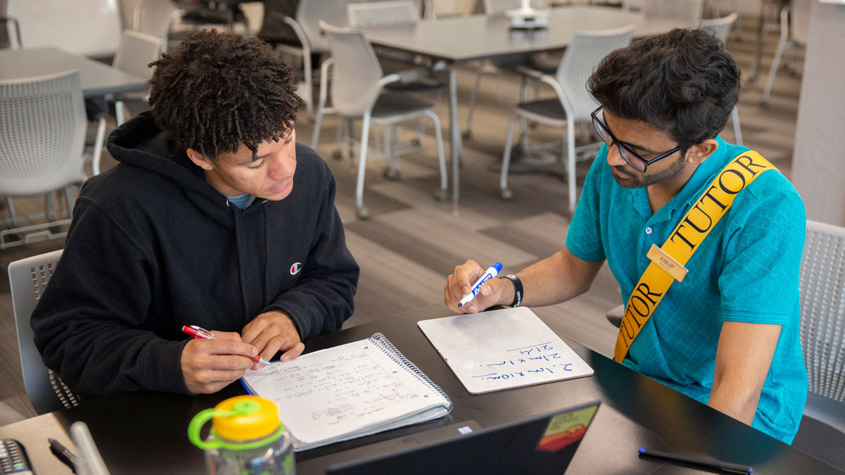 A Fulton Schools tutor works with a student in a Fulton Schools Tutoring Center